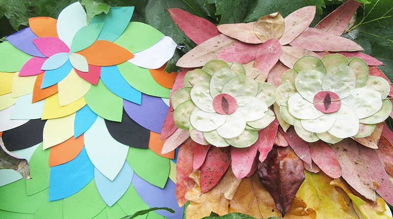 Owl mask made from autumnal leaves and a brightly coloured paper mask of a tree