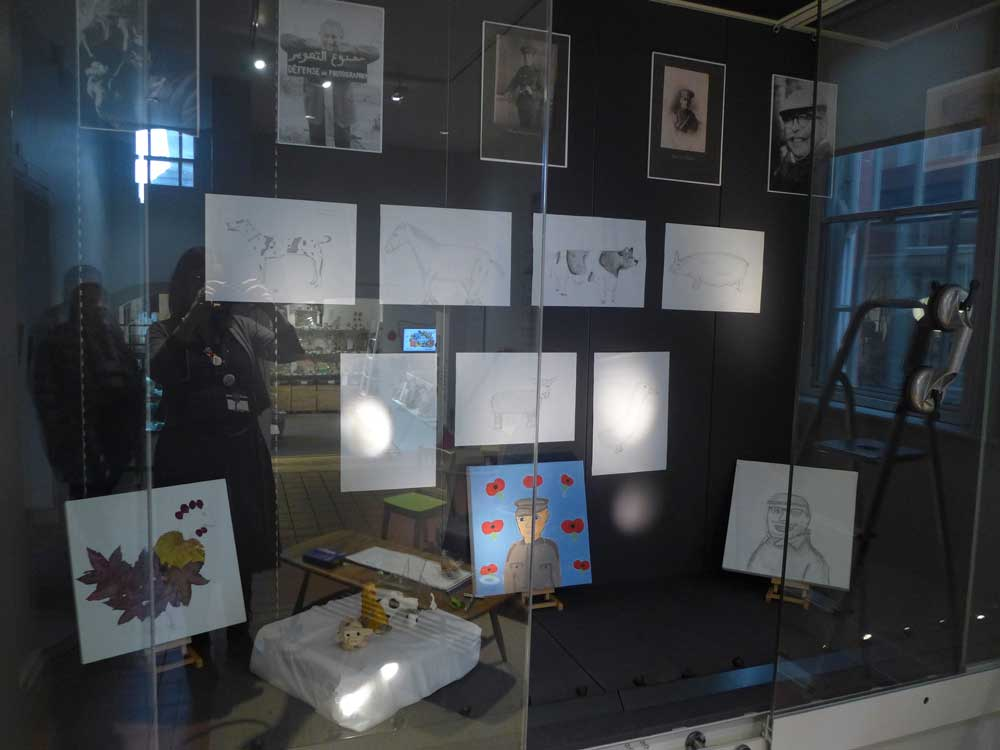 Student artwork displayed in a glass case