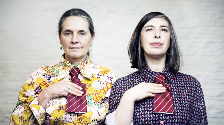 Sheila Ghelani & Sue Palmer wearing brightly coloured shirts and stripy ties which have been cut off, from Common Salt