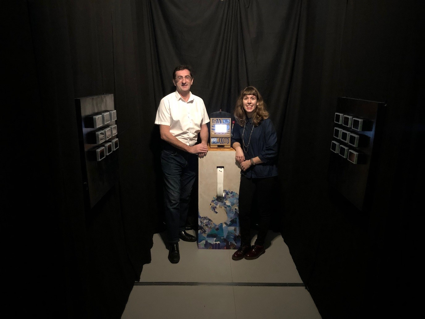 "Stuart Mitchell and Louise Arnal in the ""Gambling with floods?"" exhibition space at The MERL"